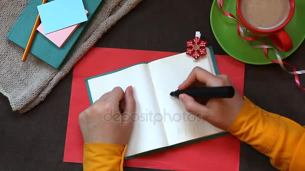 Kézi írás szó hamarosan a notebook, felülnézet