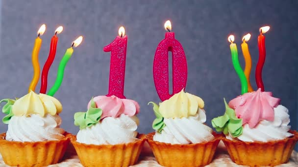 Happy 10 Birthday Cakes And Pink Number Candles Stock Footage