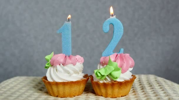 Happy 12 birthday, burning blue number candles on cupcakes