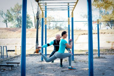 Woman working out with her trainer