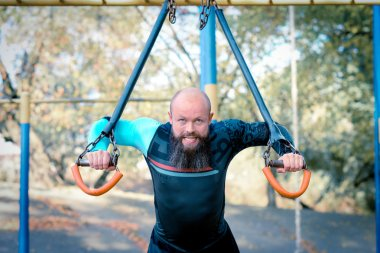 Man working out at outdoors gym
