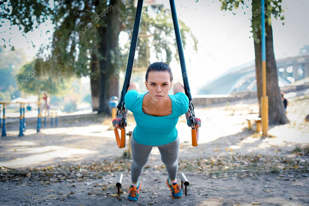 Woman working out with sport equipment