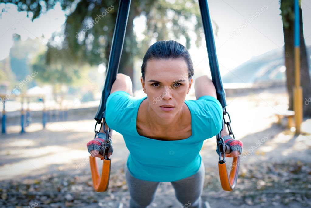 Active woman doing exercises in park