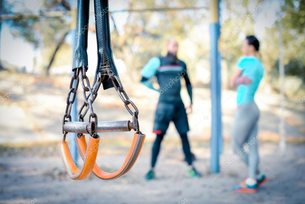 Couple working out with sport equipment on foreground