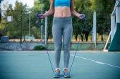 Fotografie Ženy cvičení se švihadlo