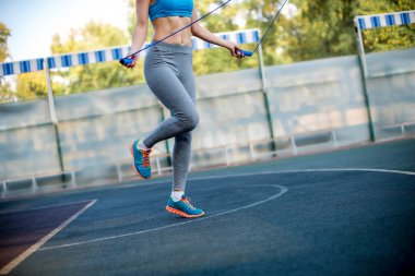 Woman exercising with rope jumping