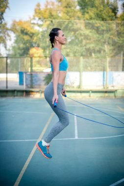Active woman using jump rope