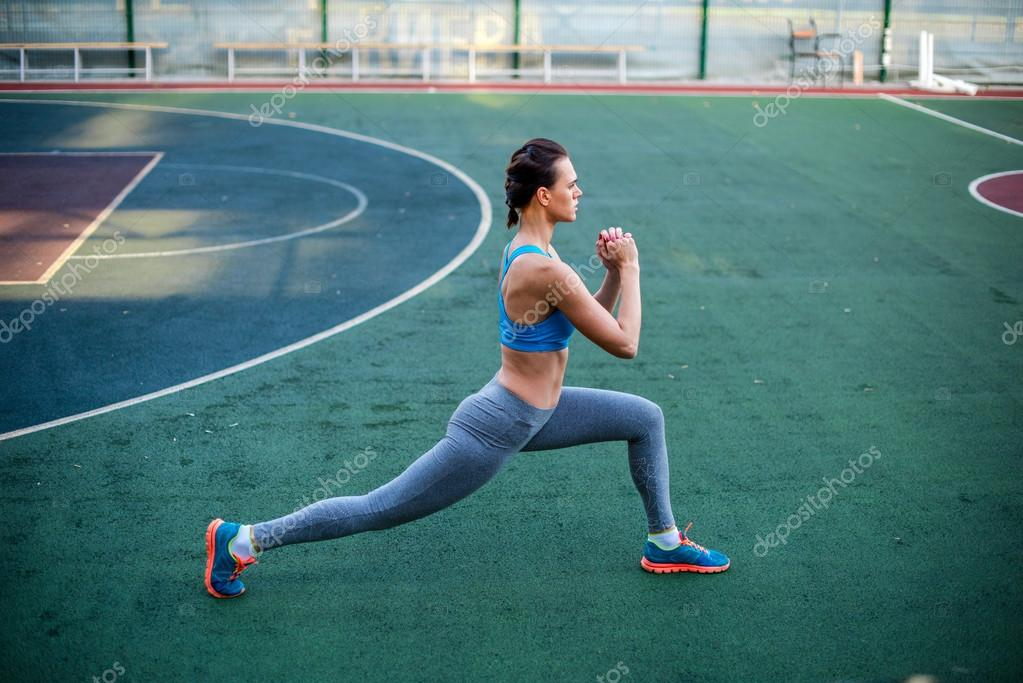 Woman training on stadium