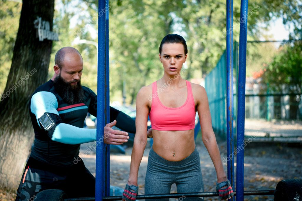 Woman during workout with her coach