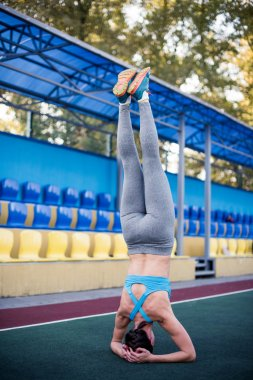 Woman doing head stand