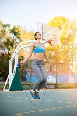 Sportswoman with skipping rope