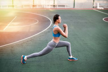 Woman exercising on stadium