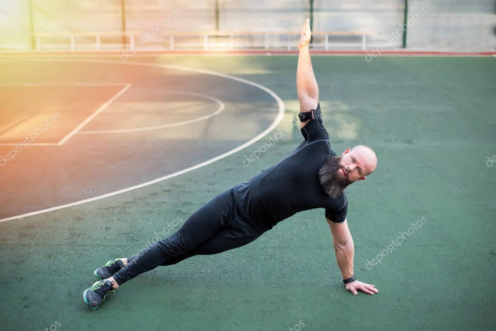 Man exercising on stadium