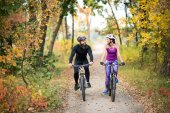 Fotografie Couple cycling outdoors