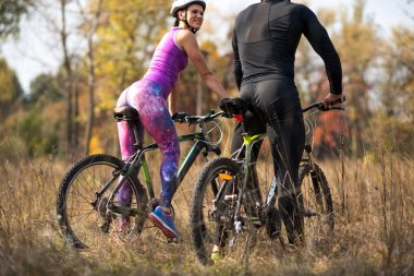 Cyclists in autumn park
