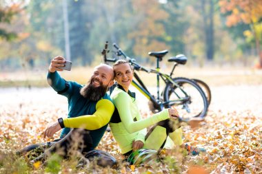 Couple of cyclists taking selfie