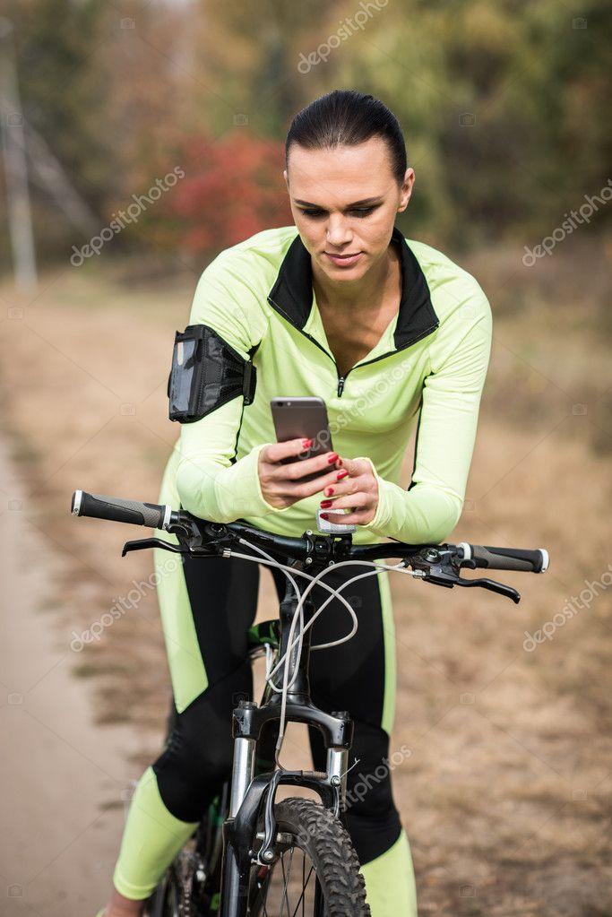 Female cyclist using smartphone