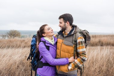 Happy young couple with backpacks