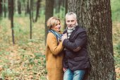 Beautiful mature couple in autumn park
