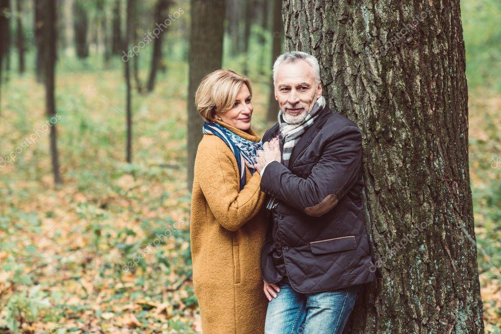 Beautiful mature couple in autumn park