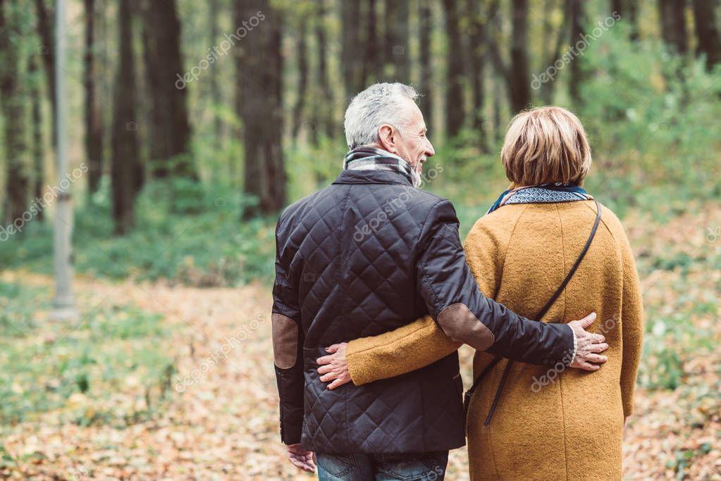 Mature couple walking in autumn park