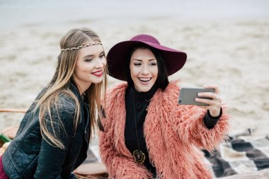 Beautiful smiling women taking selfie