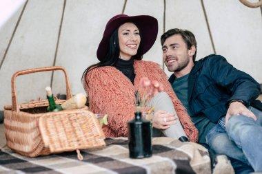 Couple under umbrella at picnic