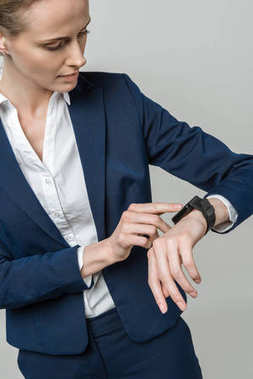 Businesswoman using smart watch