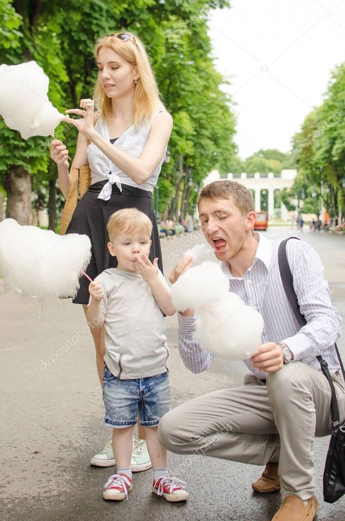 Young family is eating cotton candy
