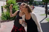 Two girlfriends are eating icecream