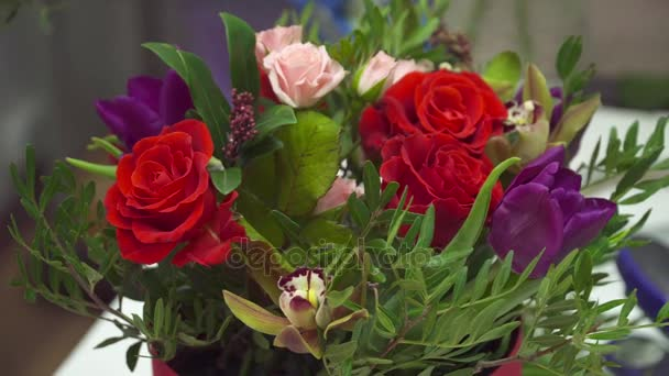 Closeup of beautiful bouquet with the roses and tulips done