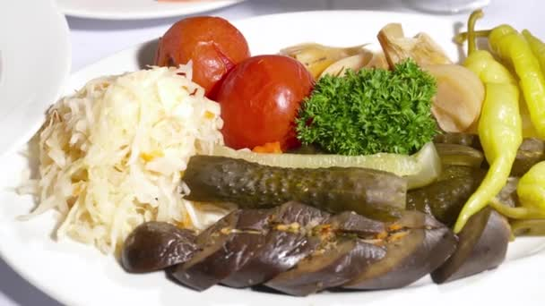 Set of pickled vegetables with herbs