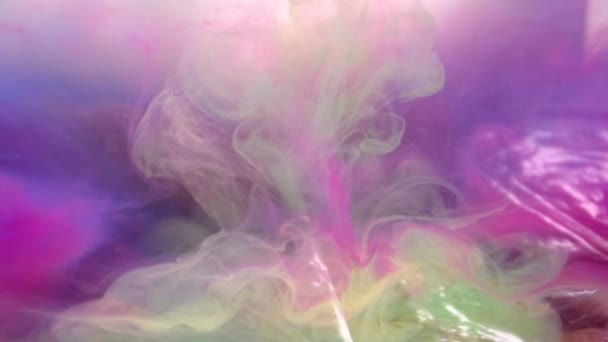 Different colors of ink in water abstract background texture slow motion
