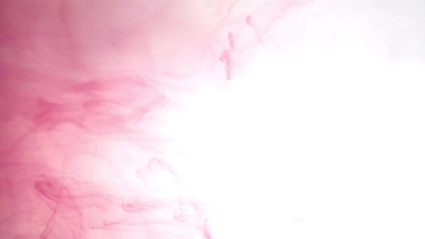 Blue and yellow ink in colored water abstract background texture slow motion