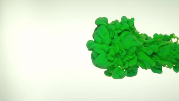 Deep green ink in water abstract background texture slow motion