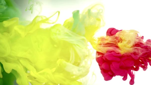 Deep red ink in colored water abstract background texture slow motion