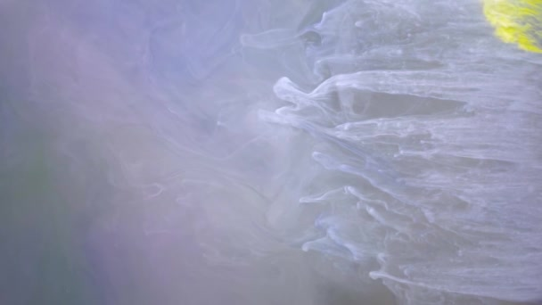 Yellow ink spreading in water abstract background texture slow motion