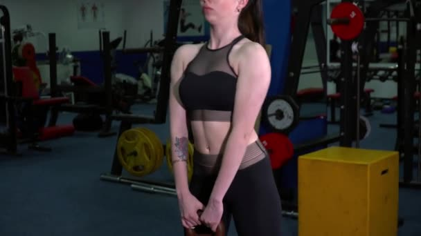 Young woman training with the kettlebell closeup