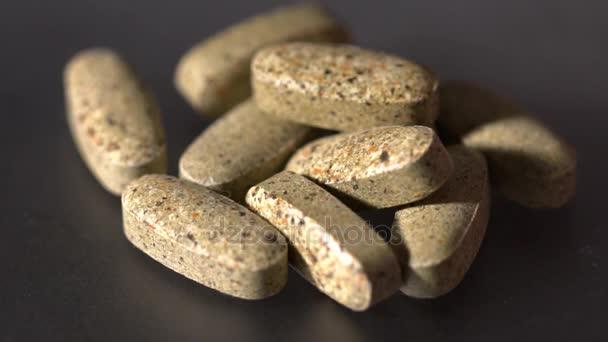 Closeup of vitamin pills on the black background