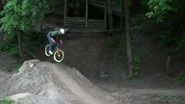 Dirt riding in the green forest slow motion