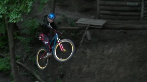 Dirt riding with tricks in the forest slow motion