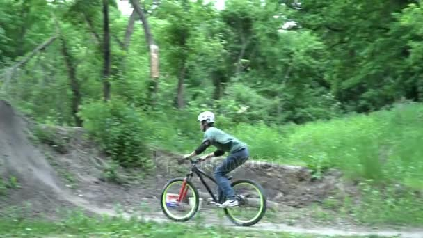 Dirt rider making tricks on bike in the forest slow motion