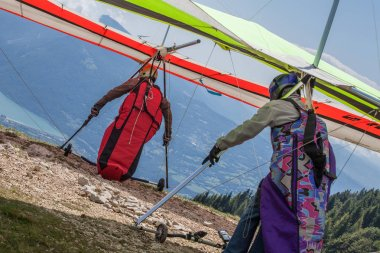 hang gliders taking off, mountain