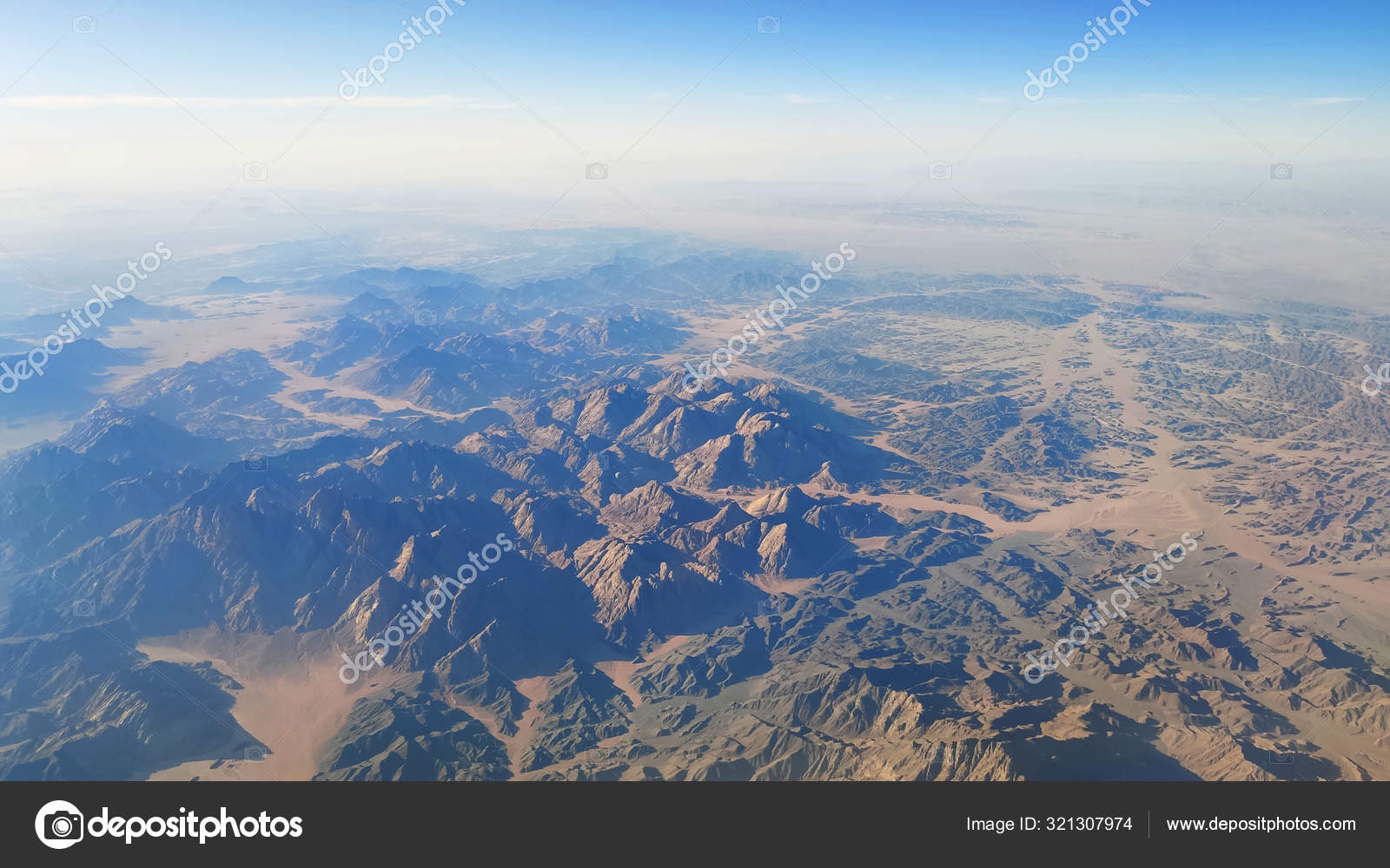 Beautiful view from the window of an airplane mountains