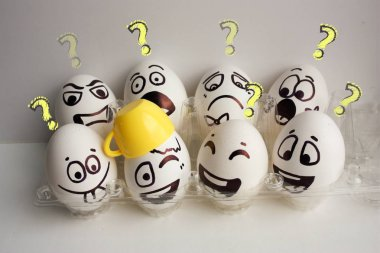 Eggs face. A cheerful egg company with eight pieces with a mug on the head. Photo for your design. Question concept. stock vector
