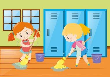 Two girls mopping locker room