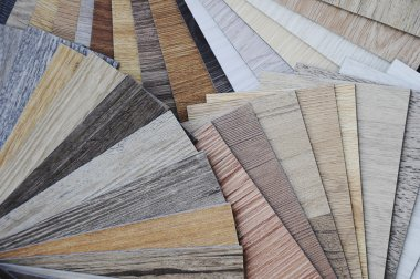 laminate wood texture floor :oak tile, maple tile, chestnut tile, walnut tile, balsam tile,   Samples of laminate and vinyl floor tile on wooden Background. Laminate use in the house, Hospital, Townhouse, Condominium, Hotel, Apartment, Department