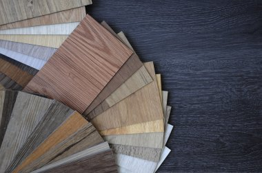 Samples of laminate and vinyl floor tile on wooden Background wo