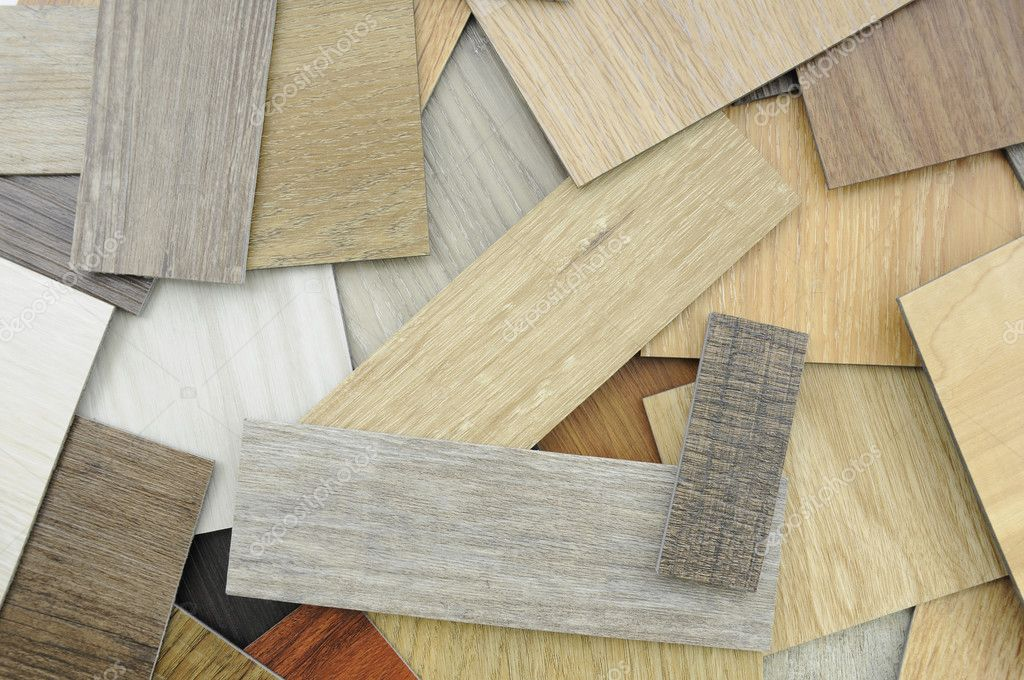 ,   Samples of laminate and vinyl floor tile on wooden Backgroun