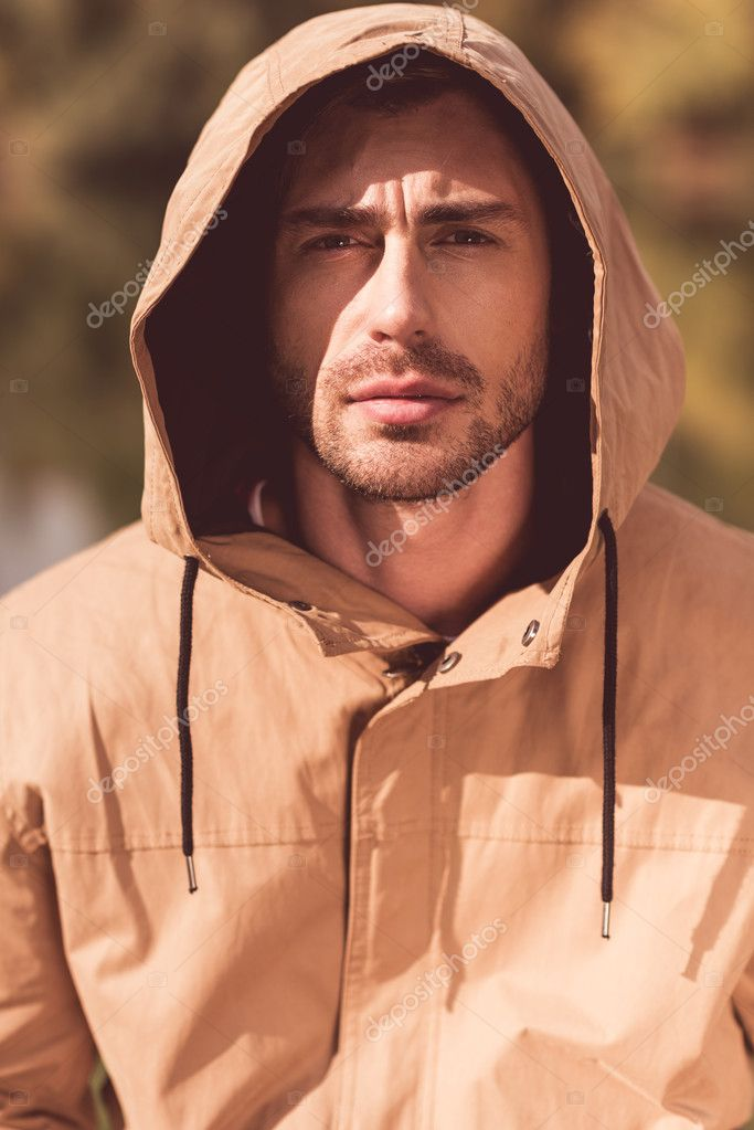Handsome man in jacket with hood